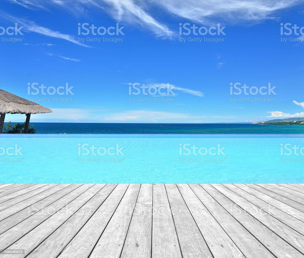Luxury infinity pool overlooking tropical sea stock photo
