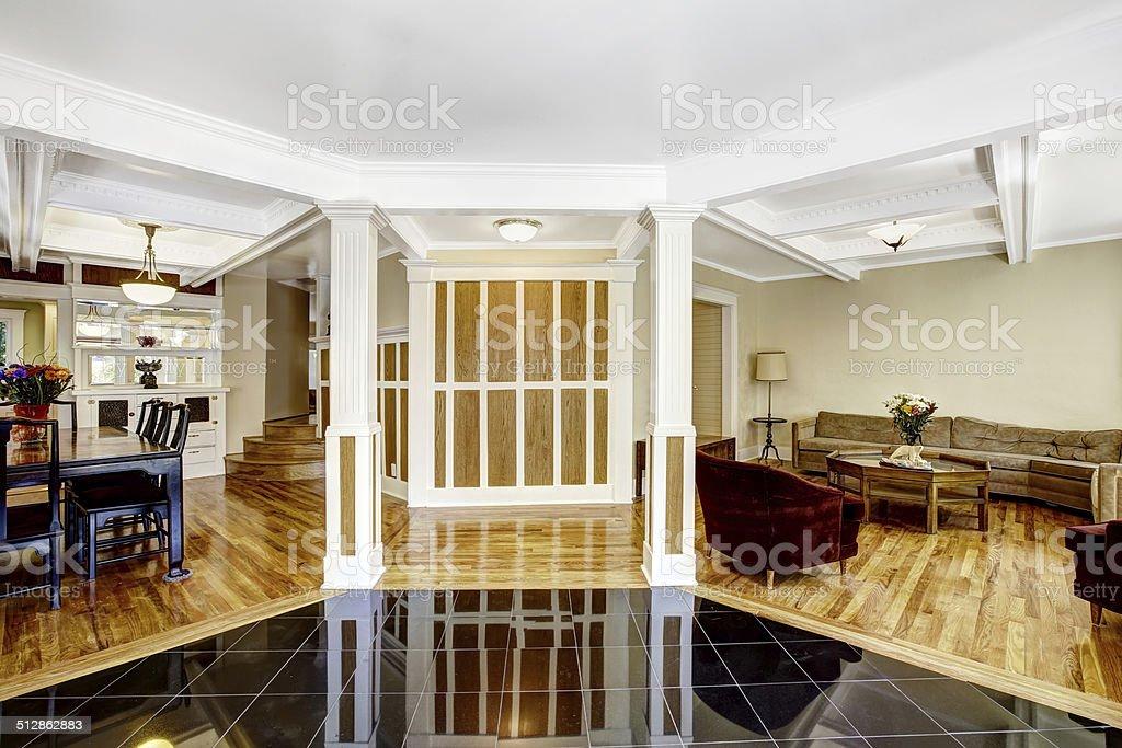 Luxury interior. Foyer with black shiny tile floor, columns and stock photo