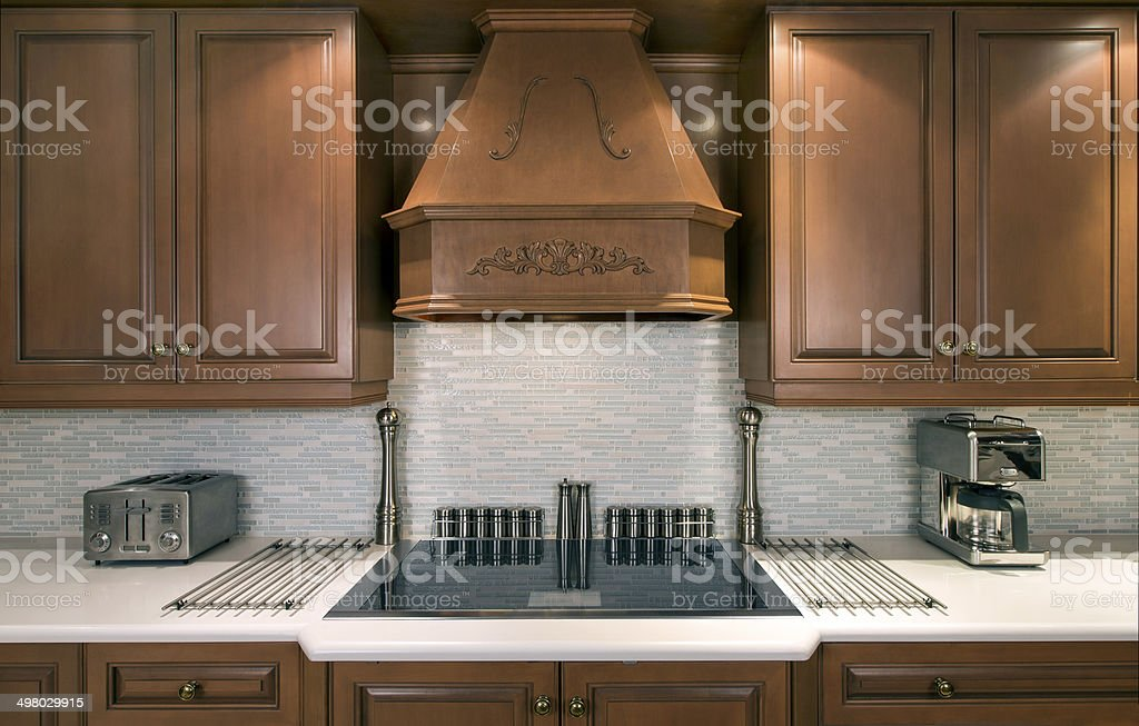 Luxury kitchen with cooktop stock photo