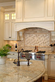 Luxury kitchen with granite countertops and chef style stove