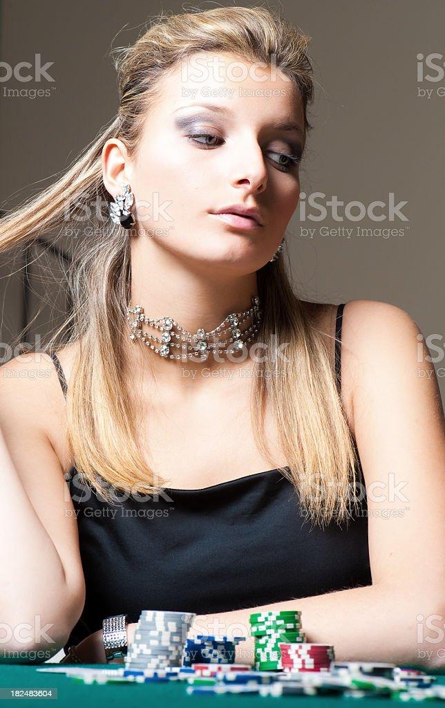 Luxury lady playing poker royalty-free stock photo
