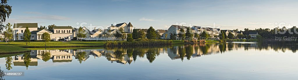 Luxury lake shore homes reflected stock photo