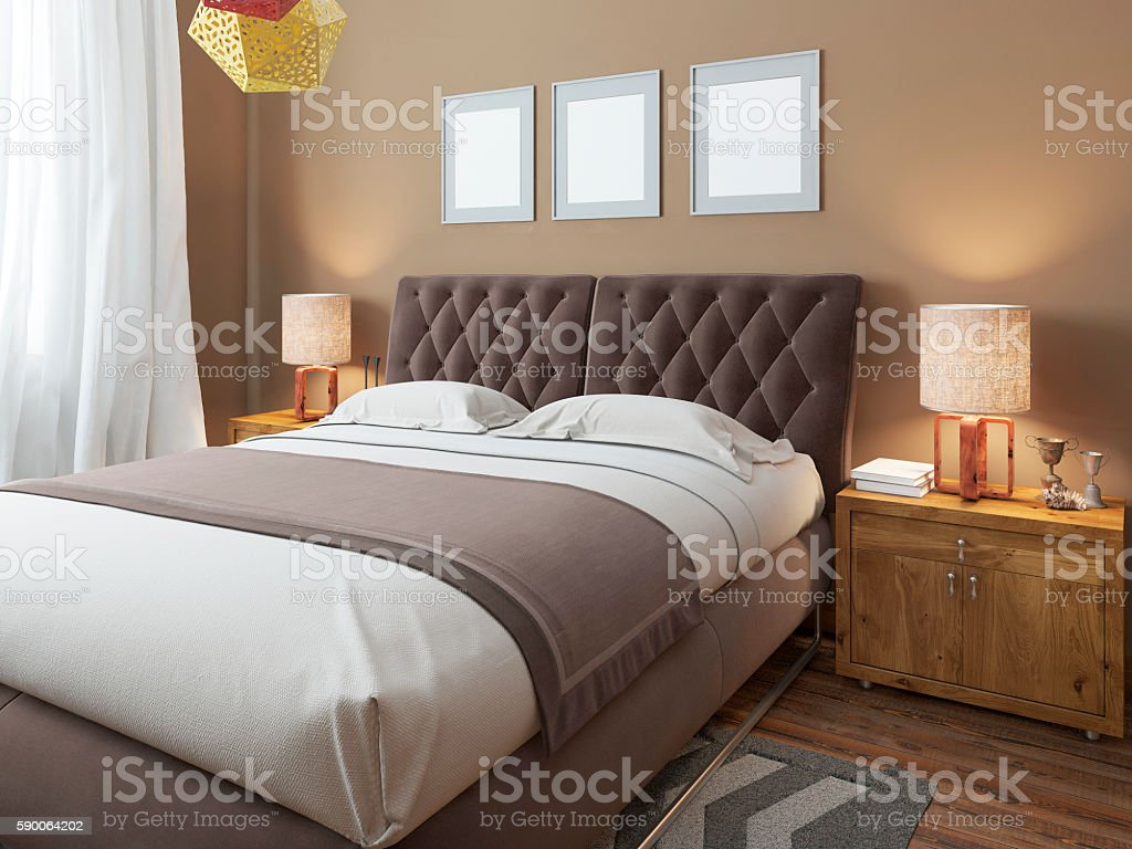 Luxury large modern double bed in the bedroom loft style. stock photo