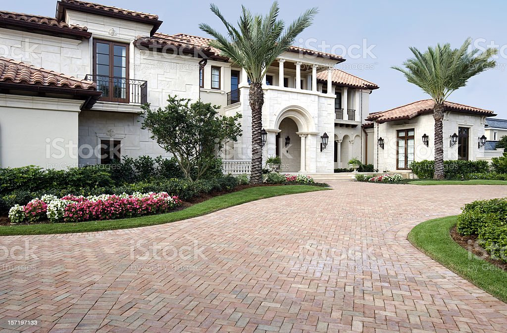 Luxury Living in this Beautiful Estate Home with Brick Pavers stock photo