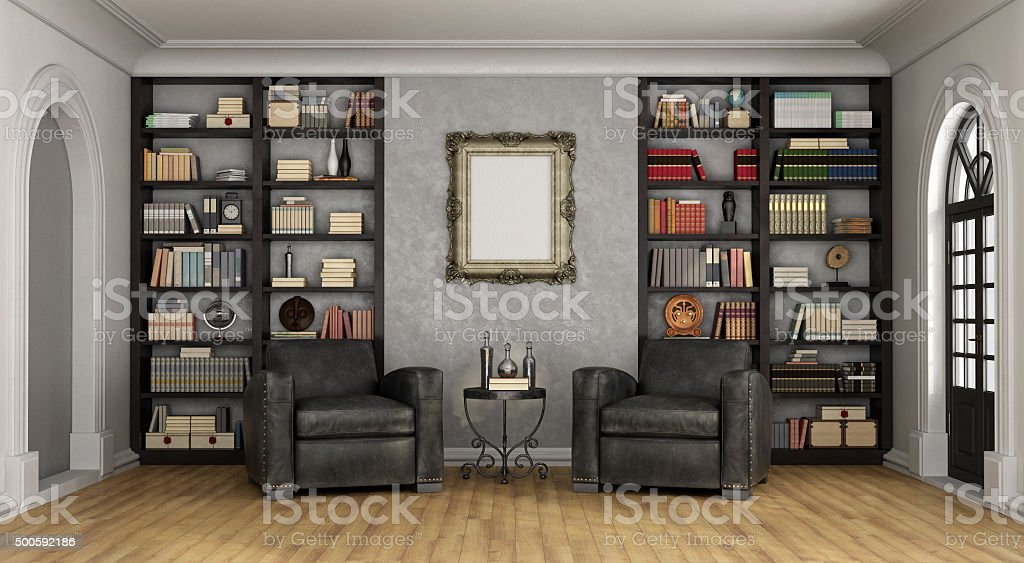 Luxury living room with large bookcase and armchairs stock photo