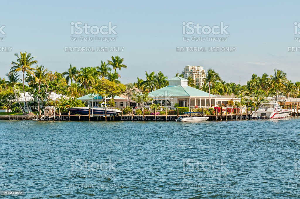 Luxury mansion with a yacht at home pier stock photo