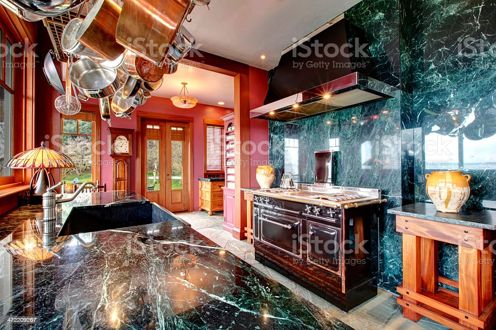 Luxury marble kitchen room with an antique style stove stock photo