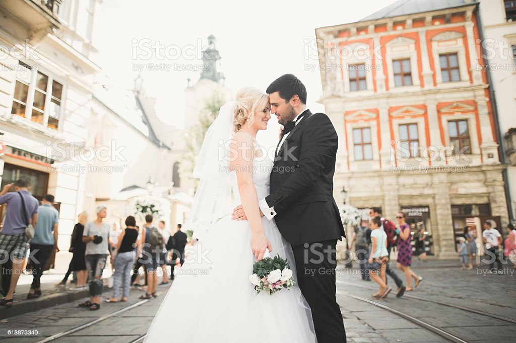 Luxury married wedding couple, bride and groom posing in old stock photo