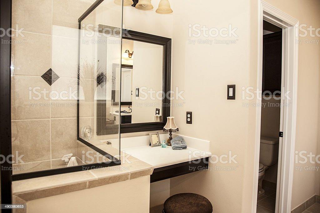 Luxury master bathroom in upscale home. Shower, woman's vanity. stock photo