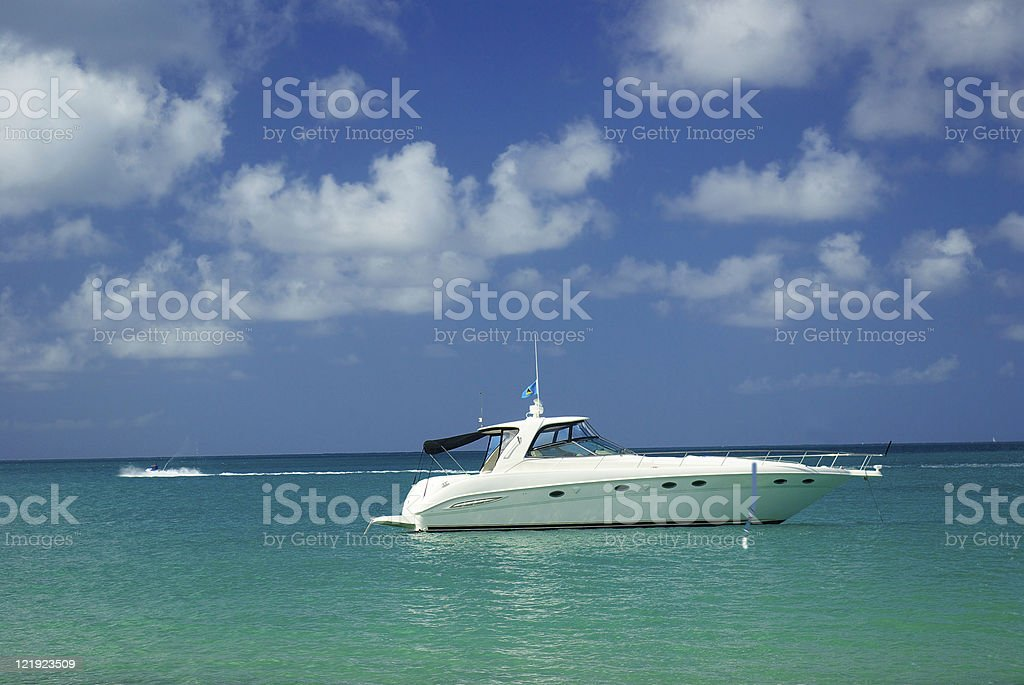 luxury motor boat on  turquoise caribbean sea and blue sky royalty-free stock photo