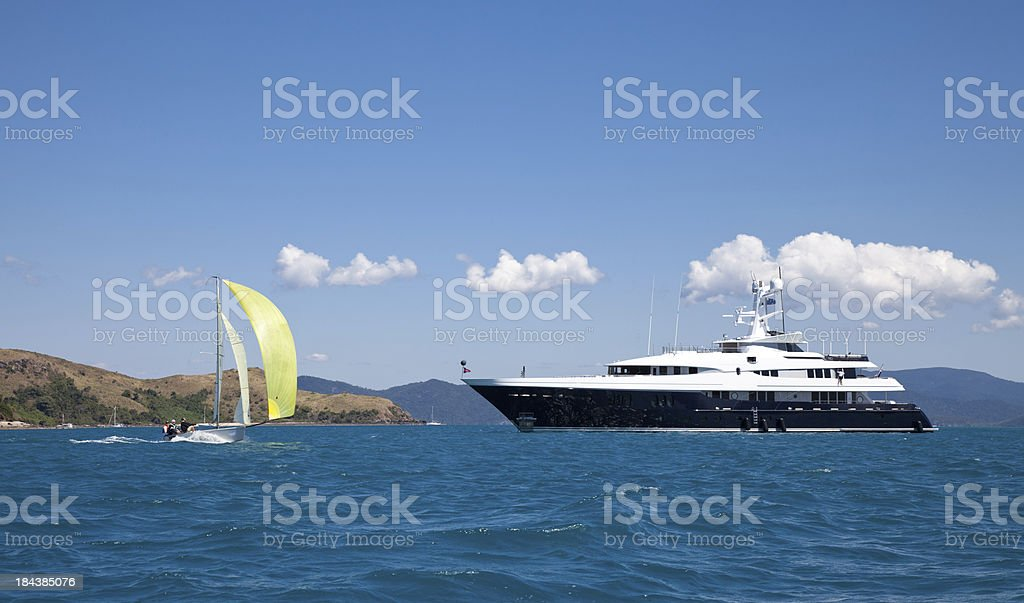Luxury Motor Yacht and Sailing Boat at Sea stock photo