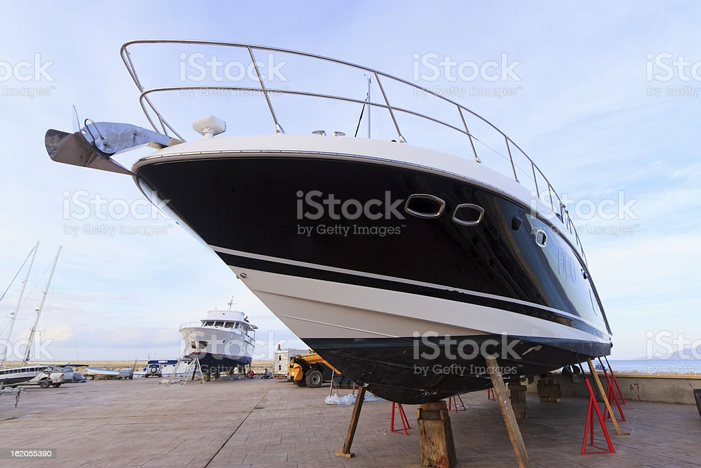 Luxury motor yacht beached for annual check royalty-free stock photo