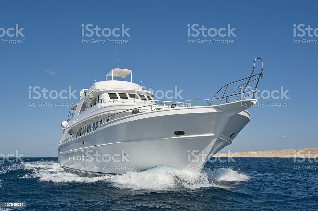 A luxury motor yacht out at sea stock photo