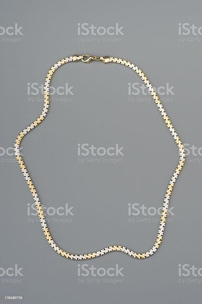 Luxury necklace on gray background royalty-free stock photo