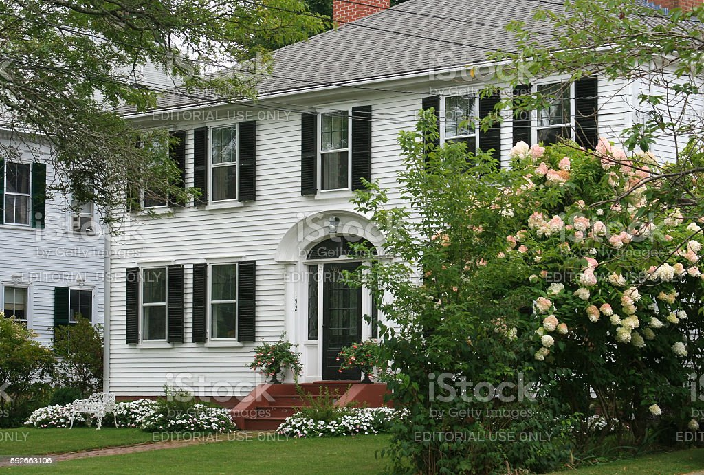 Luxury New England House with White Clapboard, Sandwich, Massachusetts, USA. stock photo