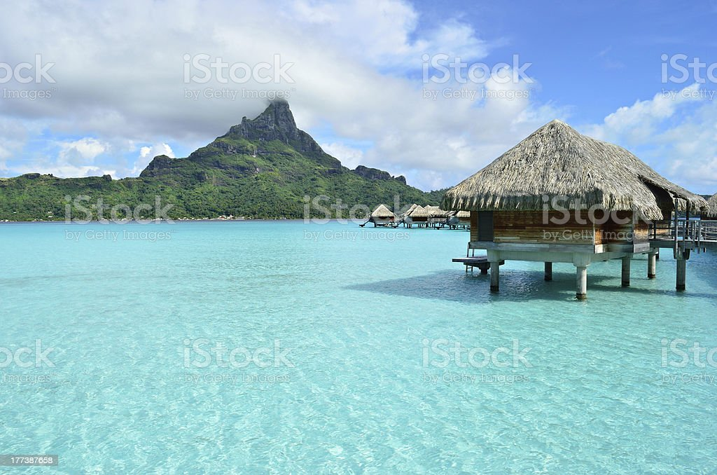 Luxury overwater vacation resort on Bora Bora island stock photo
