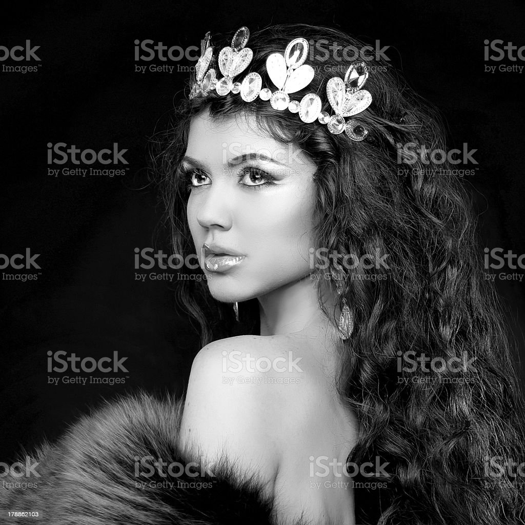 Luxury portrait. Woman with jewelry and coronet. Black royalty-free stock photo
