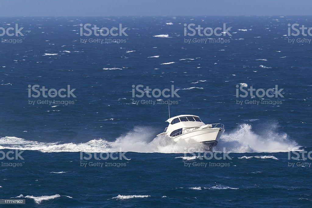 Luxury Powerboat Crashing Through Waves royalty-free stock photo