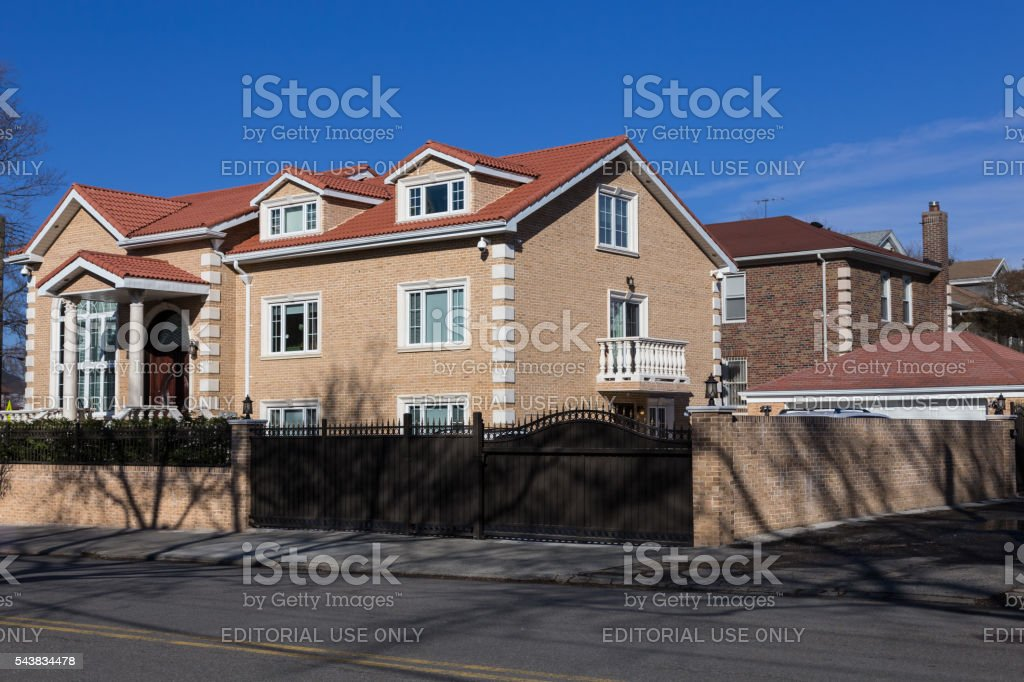 Luxury Red Brick Brooklyn House and Blue Sky, New York. stock photo