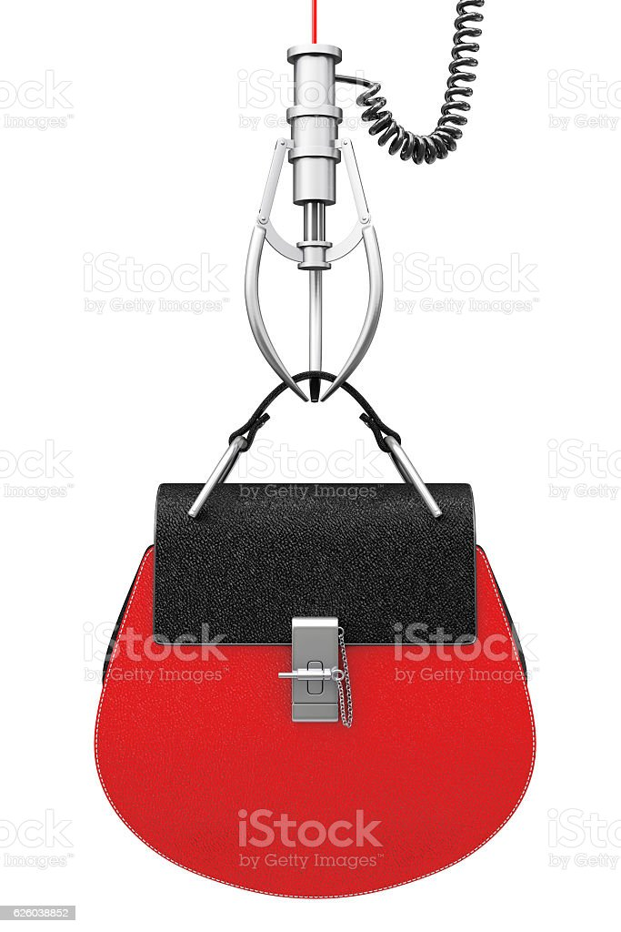 Luxury Red Leather Women Bag in Chrome Robotic Claw. stock photo