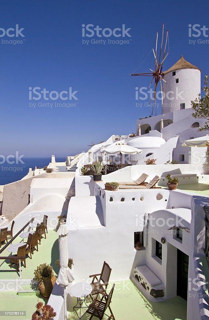 Luxury resort in Santorini with windmill in Greece stock photo