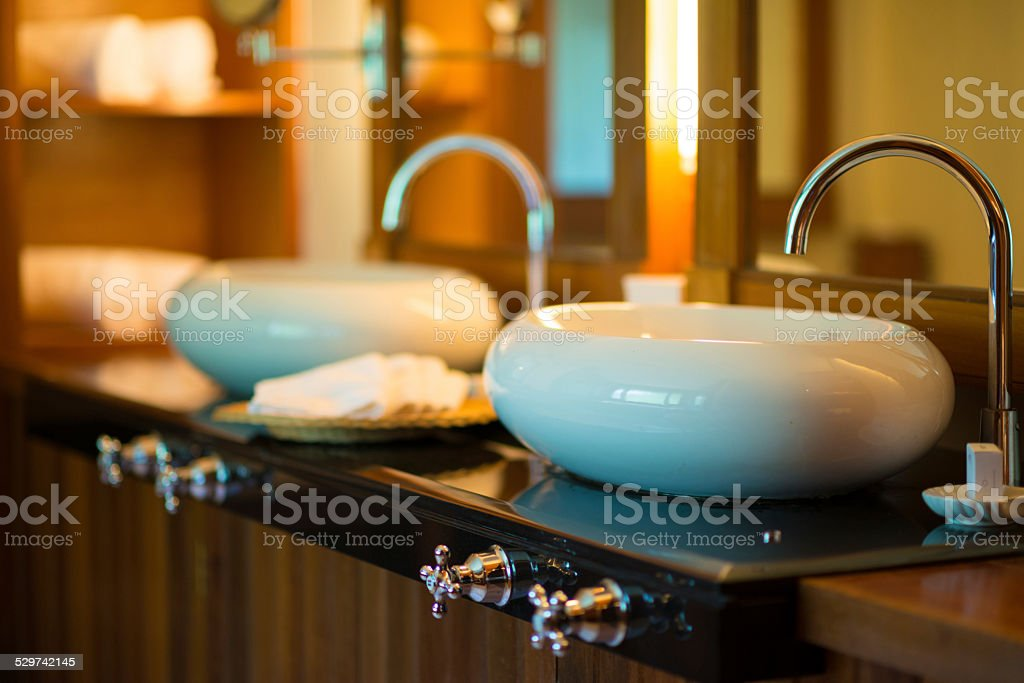 Luxury Resort Marble Bathroom Sinks and White Towels stock photo