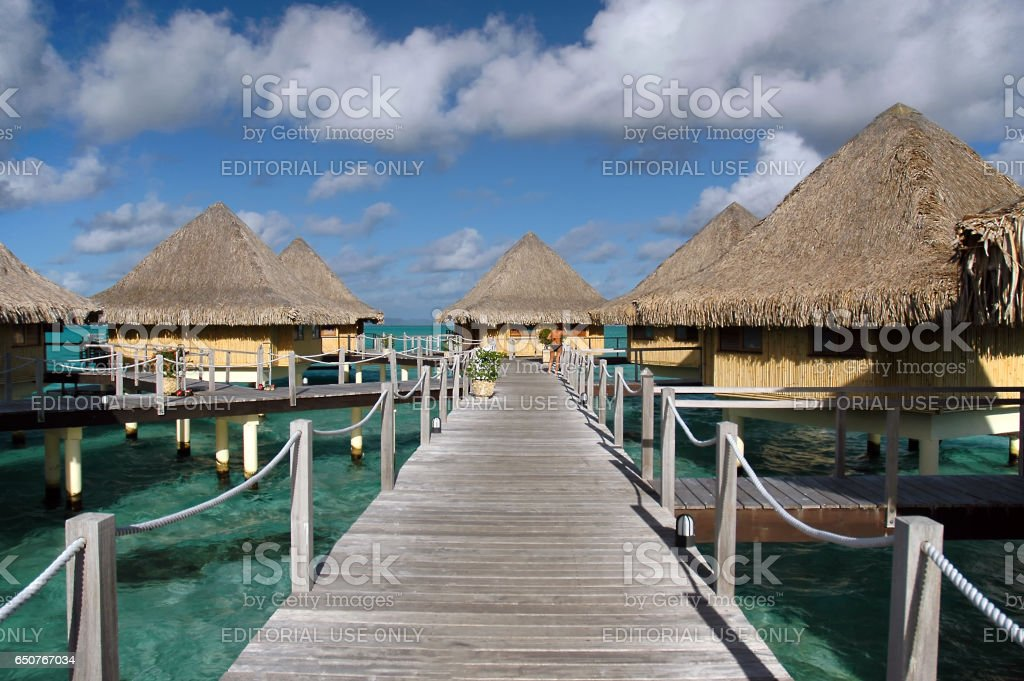 Luxury resorts offer private over water bungalows. stock photo