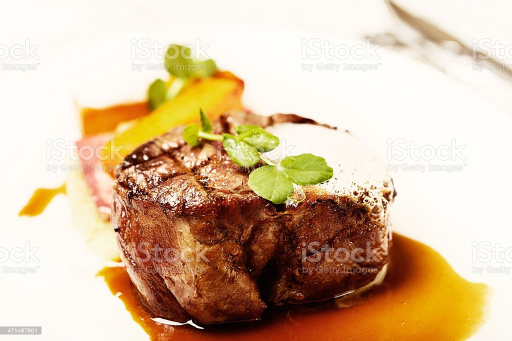 Luxury restaurant meal of grilled fillet steak with trendy foam stock photo