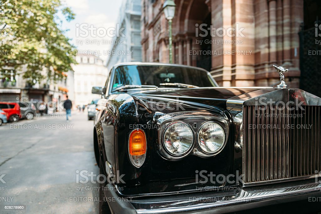 Luxury Rolls-Royce vintage limousine car in city stock photo