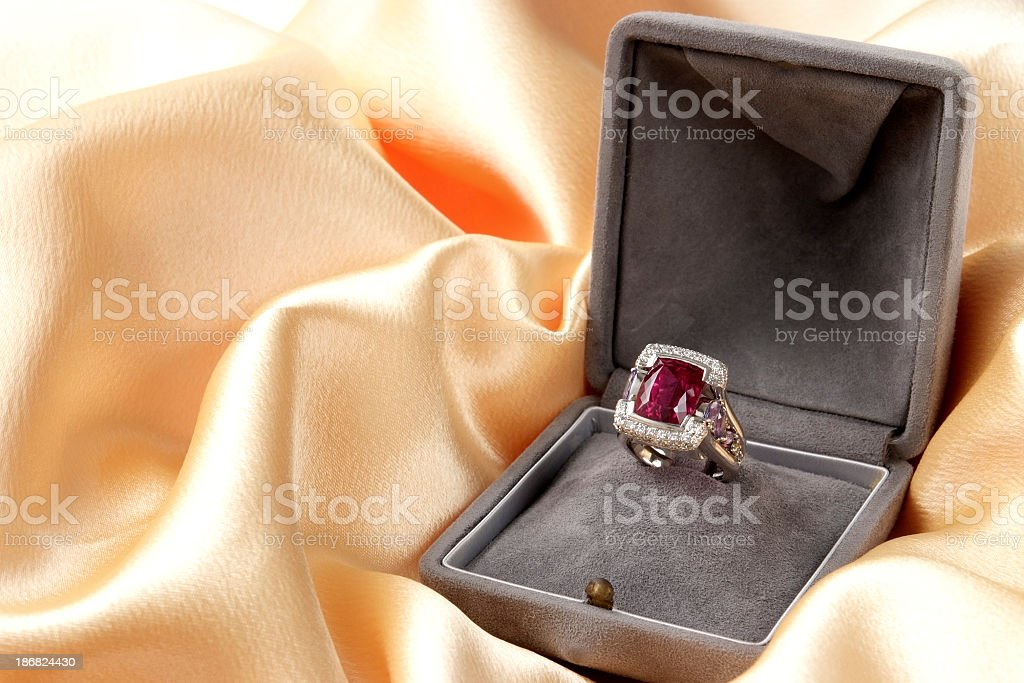 Luxury Ruby ring with diamond on gold satin royalty-free stock photo