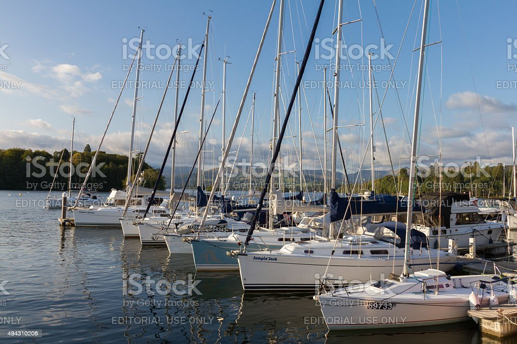 Luxury Sail Yachts moored along a Pier  in Bowness-on-Windermere, Cumbria stock photo