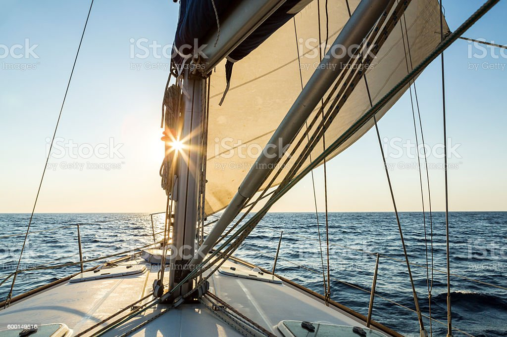 Luxury sailboat as sea facing the morning sunrise stock photo
