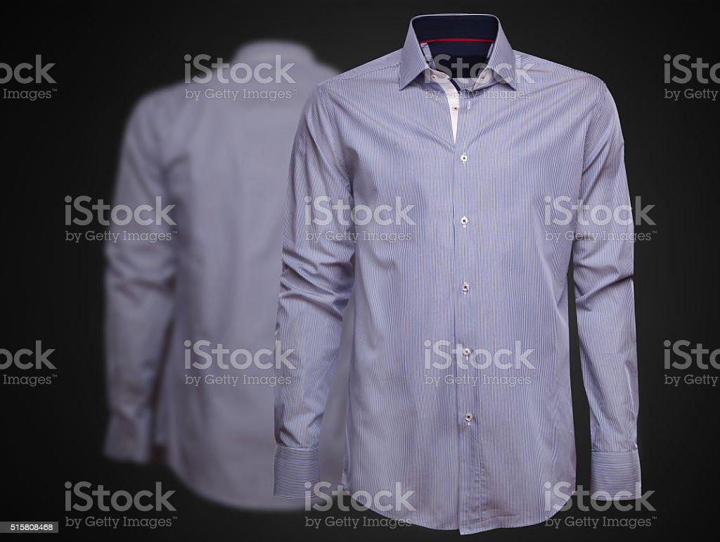 Luxury shirt on dark background. Businessman clothes stock photo