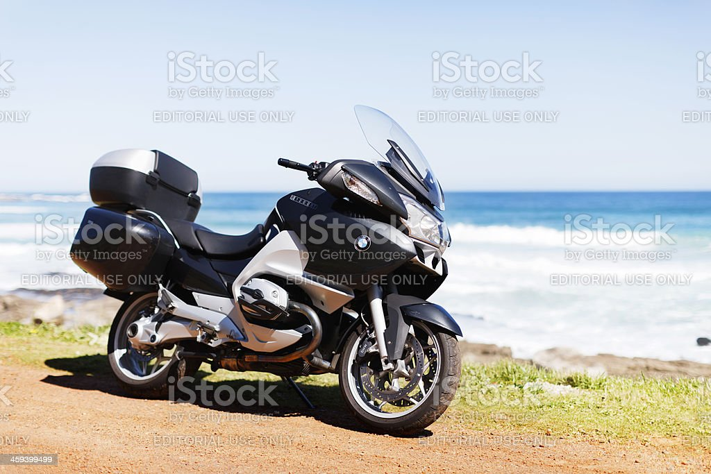 Luxury sightseeing with BMW R1200RT touring motorbike parked by seashore stock photo