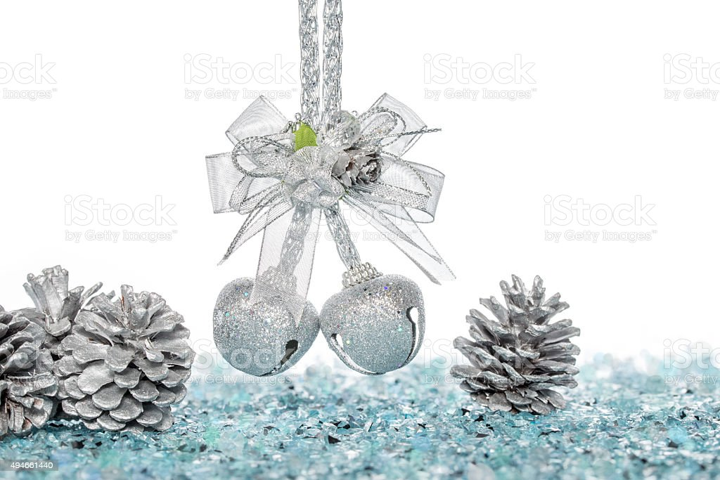 Luxury Silver jingle Bells and Pine Cone on Snow stock photo