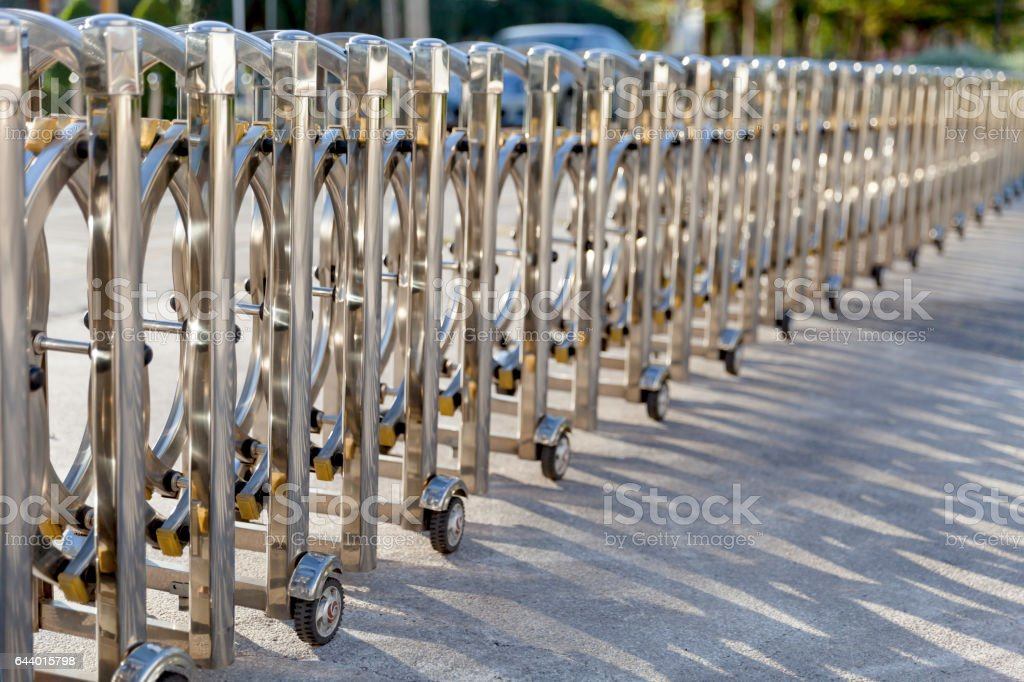 luxury sliding metal fence prevent car entering concrete road pavement stock photo