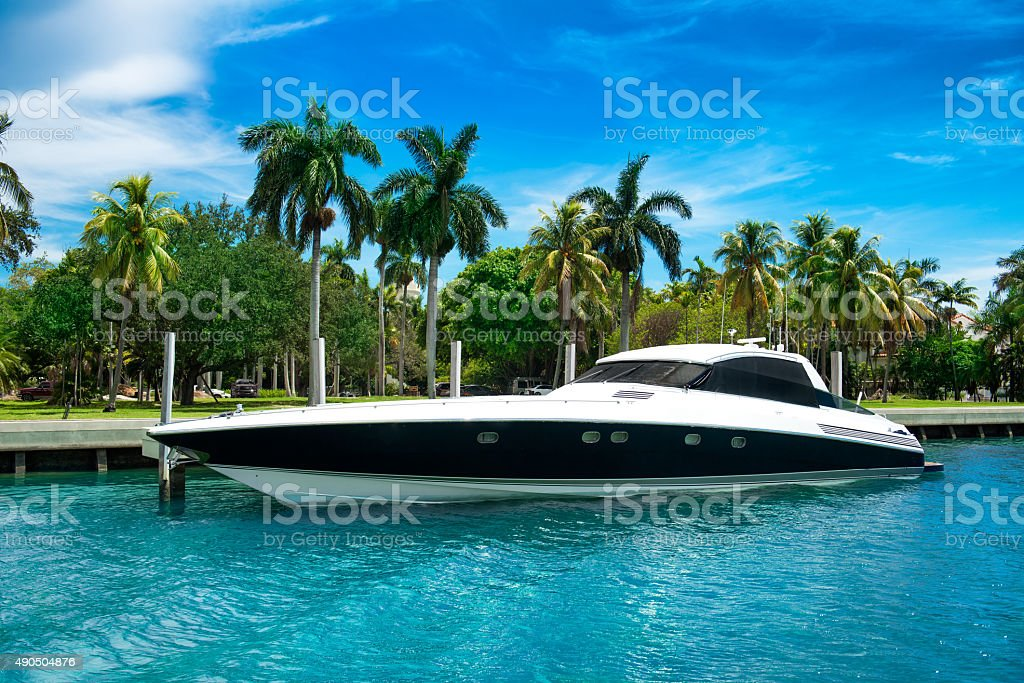 Luxury speed yacht near tropical island in Miami, Florida stock photo