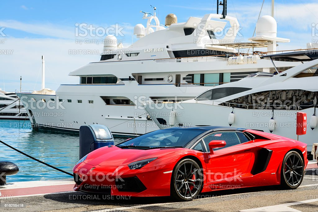 Luxury sports car and yachts at Puerto Banus in Marbella stock photo