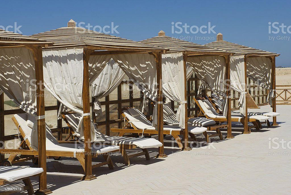 Luxury Sun Beds on the beach in Soma Bay royalty-free stock photo
