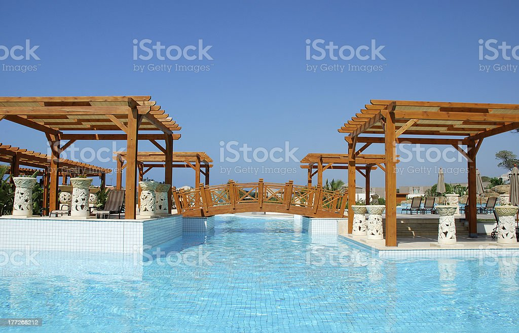 Luxury swimming pool and pergola in resort hotel royalty-free stock photo