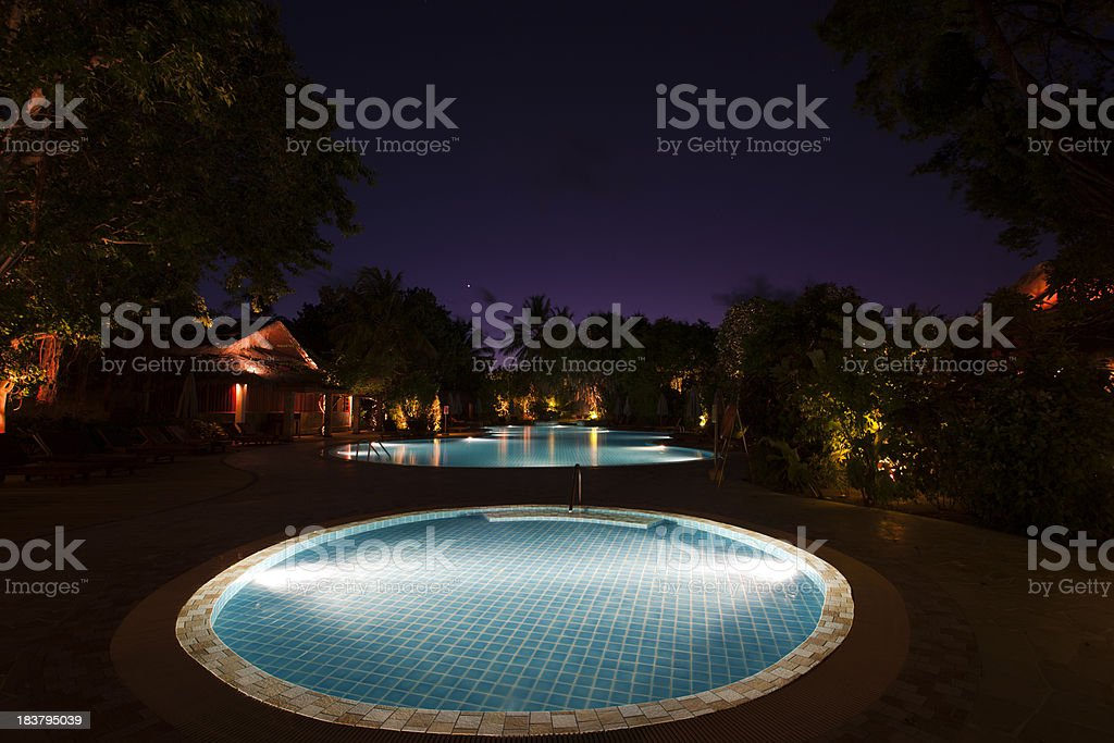 luxury swimming pool at night royalty-free stock photo