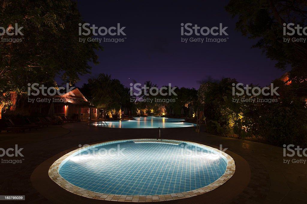 luxury swimming pool at night stock photo