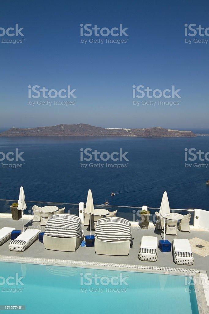 Luxury swimming pool in Santorini in Greece stock photo