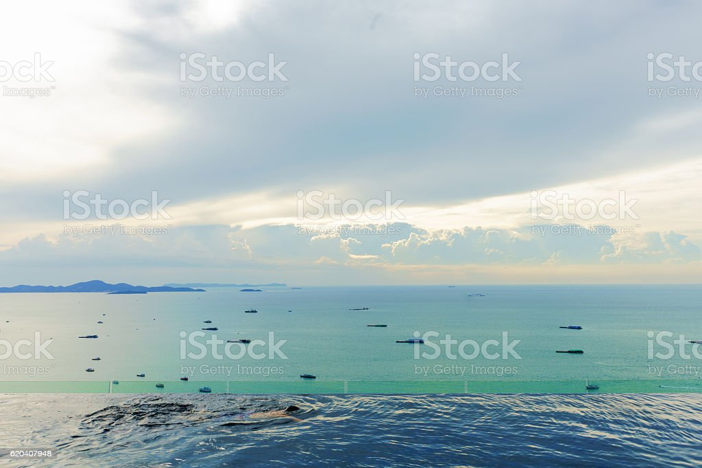 Luxury swimming pool with ocean view from Pattaya beach stock photo