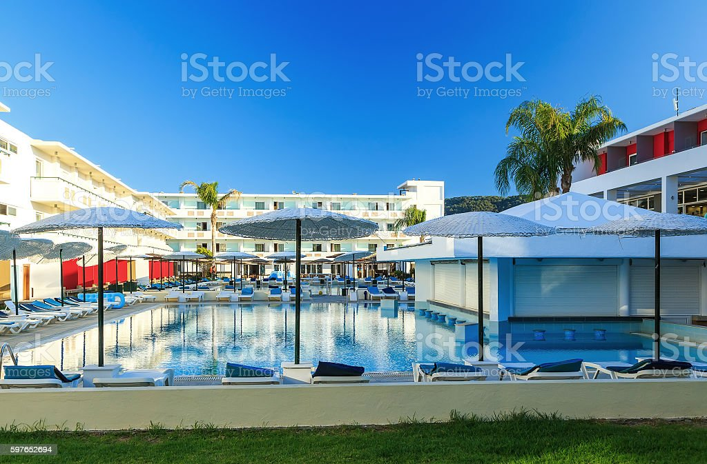 Luxury swimming pools in modern hotel sunny day Greece Rhodos stock photo