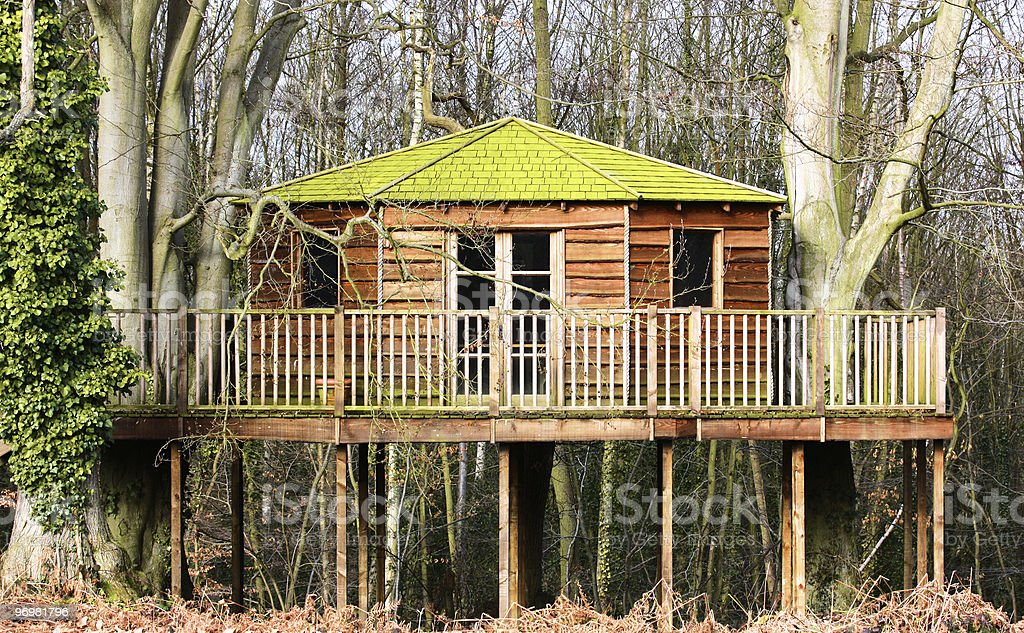 Luxury tree house in the woods stock photo