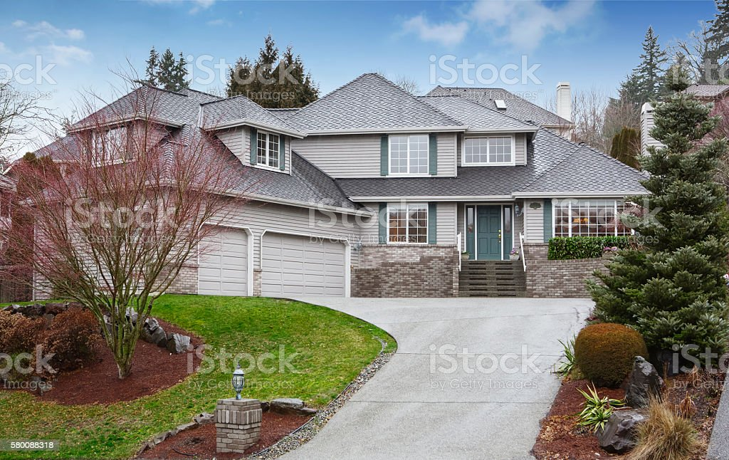 Luxury two level house with garage and driveway. stock photo