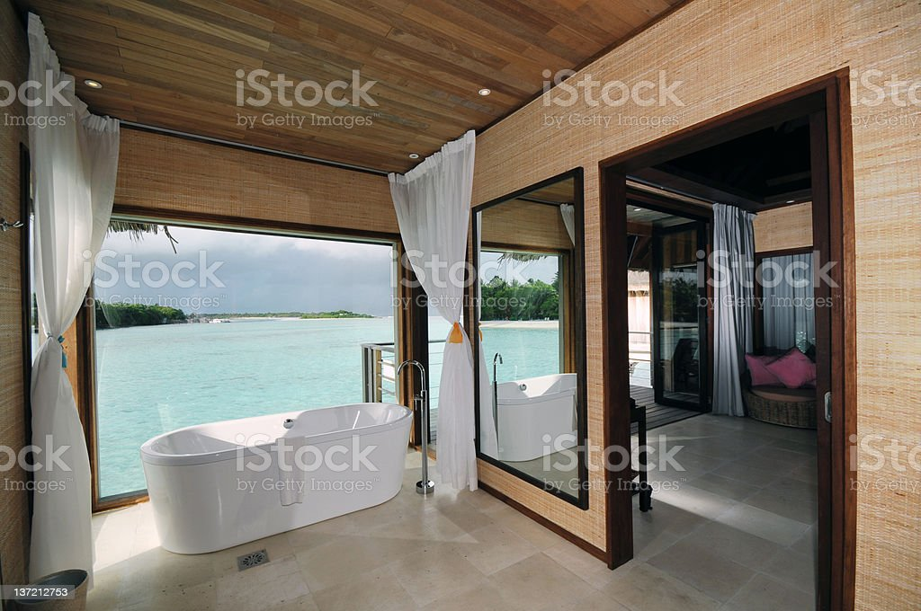 Luxury vacation suite with a sunny water view stock photo