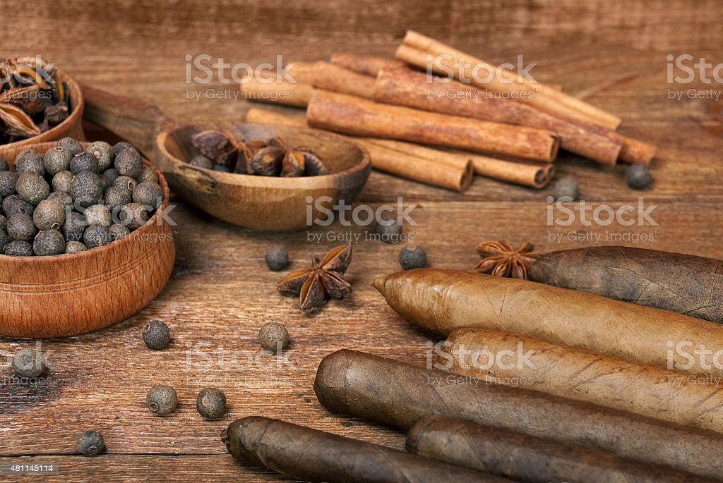 Luxury variety of Cuban cigars are on the wooden table stock photo