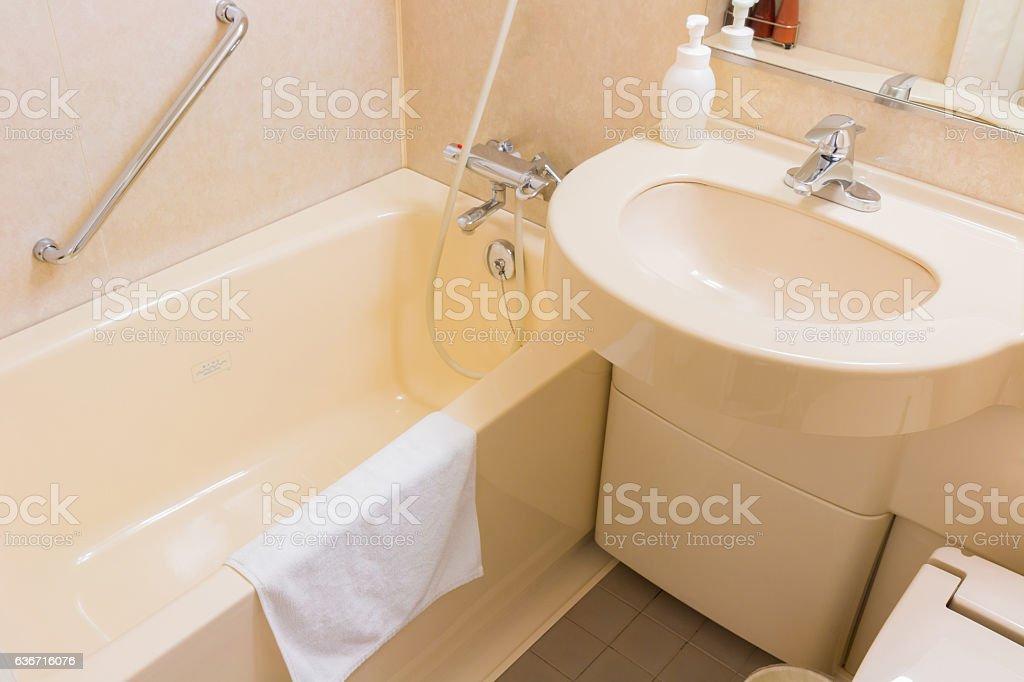Luxury wash basin and bathtub in a bathroom. stock photo